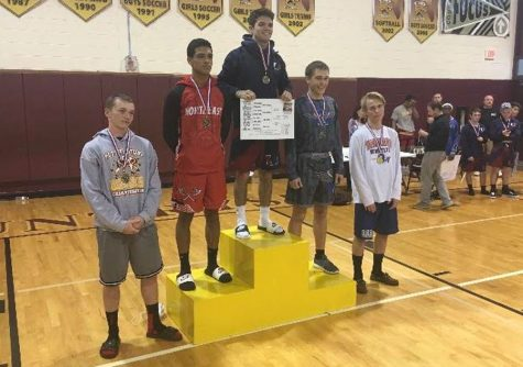 Wrestlers fight for districts