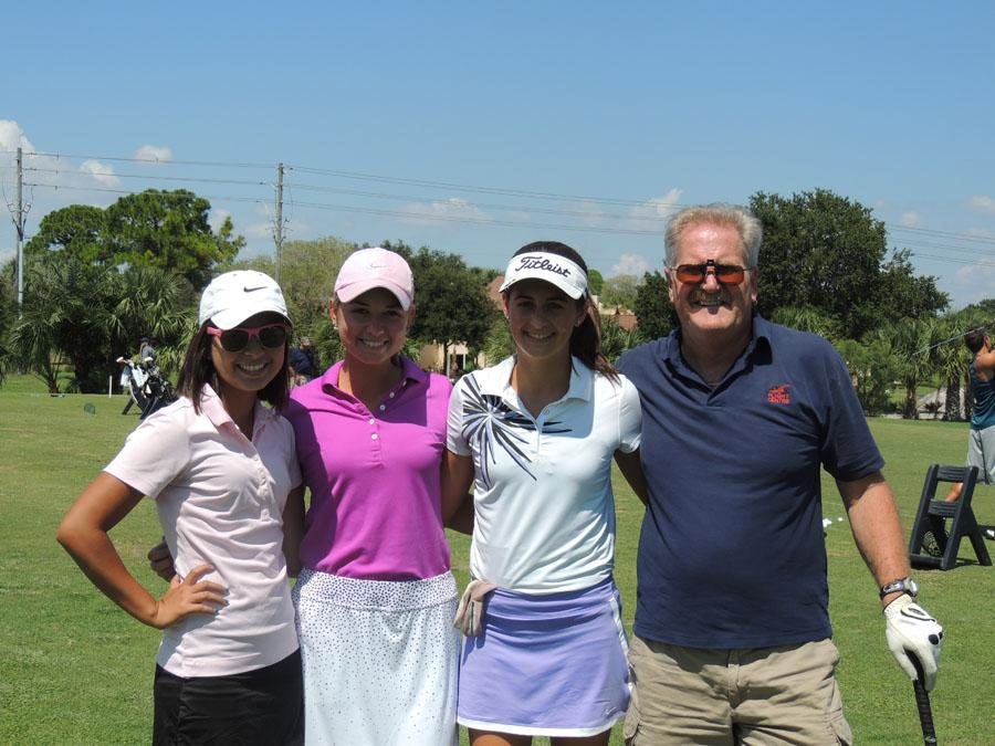 Sophie Smoot, Haydyn Gibson, and Lauren Morris with Golf Co-Coach Mr. Robinson