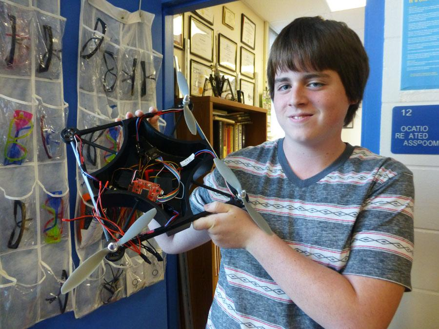 Victor Alva, a sophomore in engineering, holds up their original quadcopter design similar to what Amazon intends to use for its delivery service