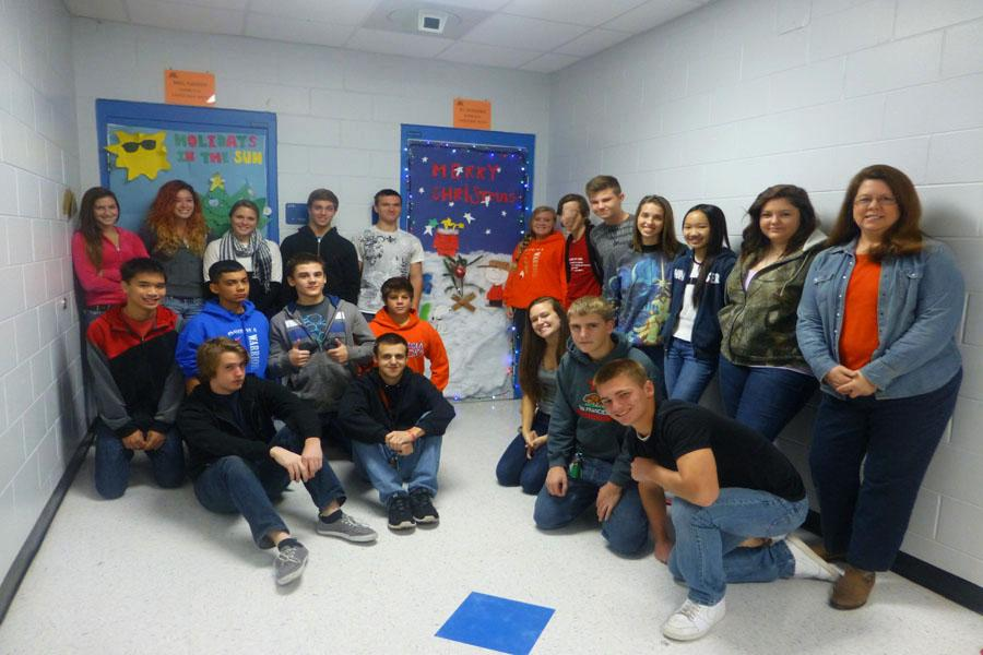 Mrs. Eubanks first period proudly stand infront of their winning door.