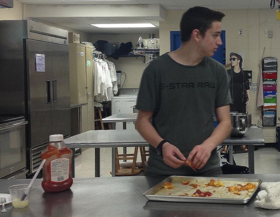Ryan+Bond+helps+prepare+Duchess+potatoes+for+Monday%27s+dinner.