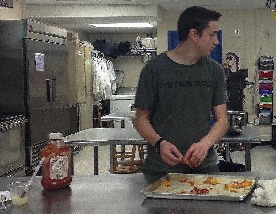 Ryan Bond helps prepare Duchess potatoes for Monday's dinner.