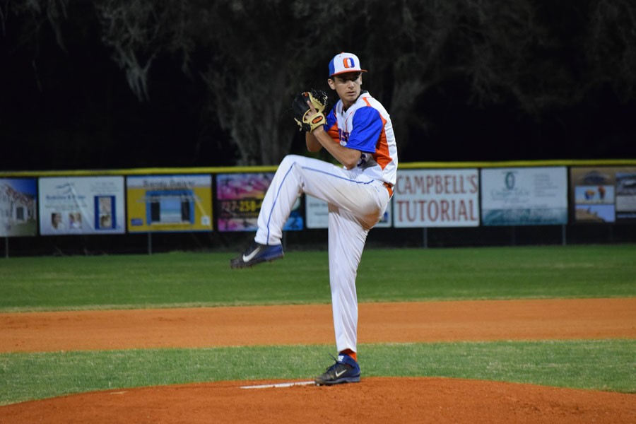 Jeremy Adams winds up a pitch.