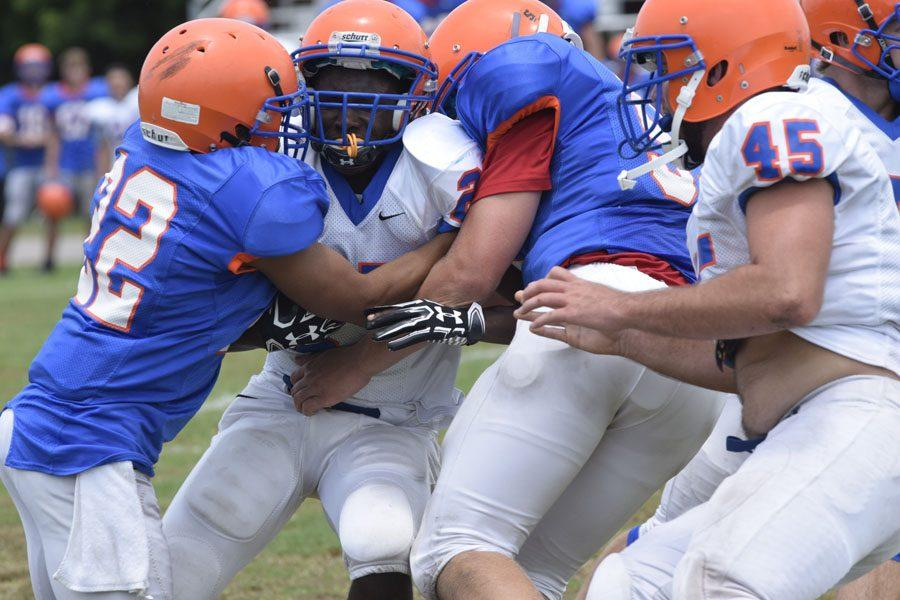 The final score of the Orange and Blue game was 28-14, Orange team (in white) won.