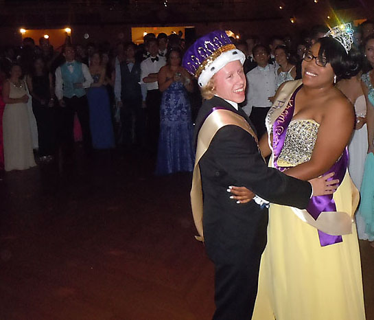 Jamiia Spradley, right, and Wesley Morgan, left, take part in the traditional king and queen dance.