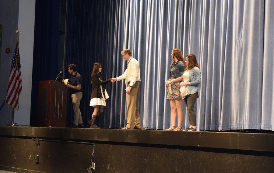 Mr. Bohnet congratulates students for their achievements.