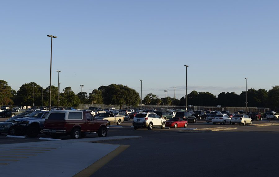 The student parking lot is quiet and almost empty.
