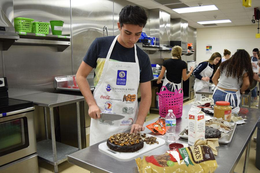 Culinary students compete to see who can make the best  cake.