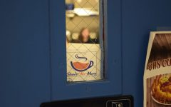 """The """"Snore No More"""" coffee cart symbol is placed in the door windows of classrooms to show that the cart is allowed to visit that room."""