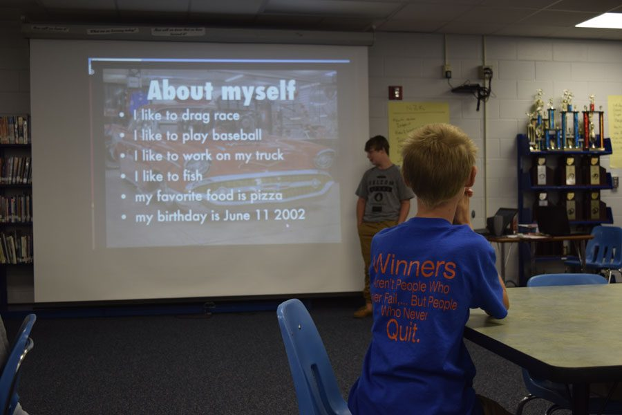 A student presents his Haiku Deck for Warrior Academy.