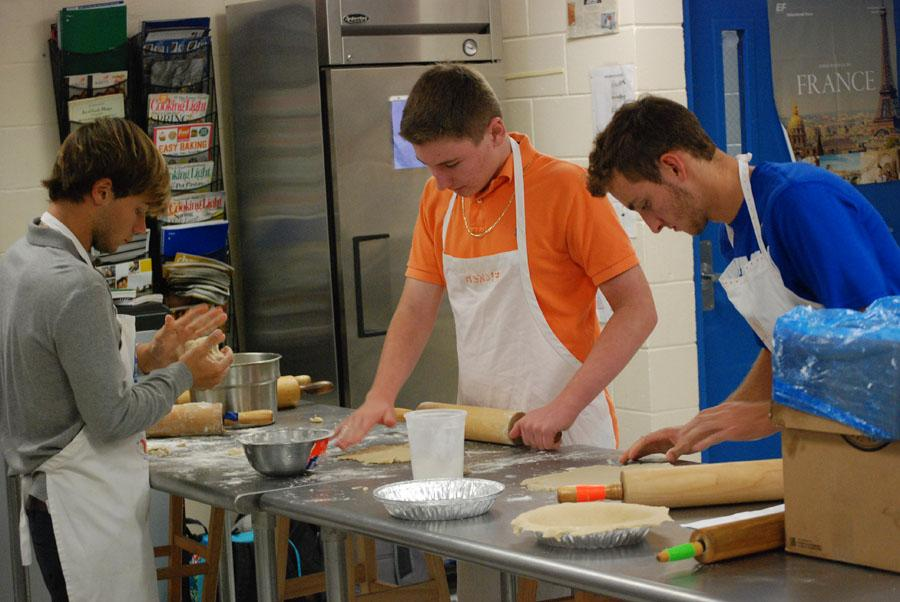 Ruslan Cidwell, 10th grade, Zane Ficken, 11th grade, and Garrett Cook, 12th grade have started to make the pie crust.
