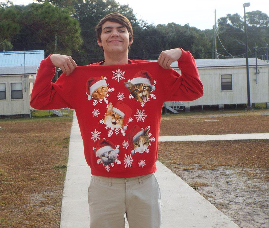 Luke McLeen shows off his Christmas sweater.