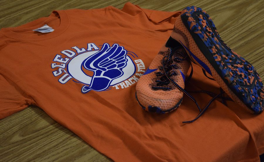 This is just some of the clothing that track students can wear from the orange and blue racing flats on race day to the old track logo shirt for school.