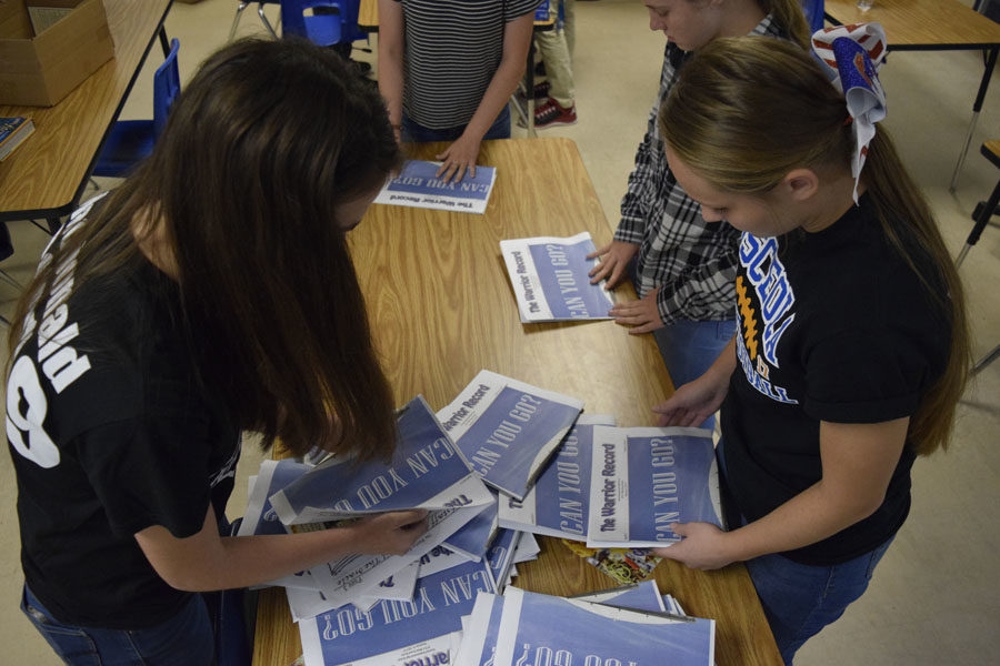 Staff members get the newspaper ready for distribution.