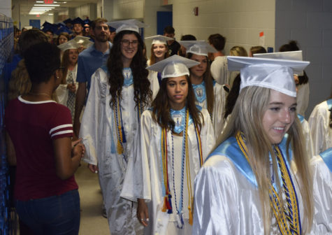 Seniors march in caps and gowns