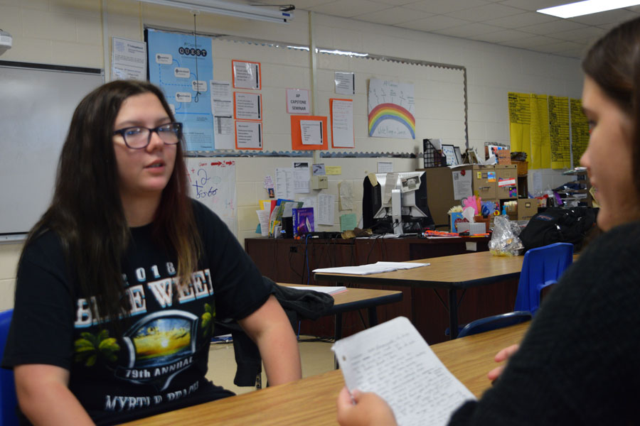 Amy Morle, grade 12, answers questions from a fellow classmate.
