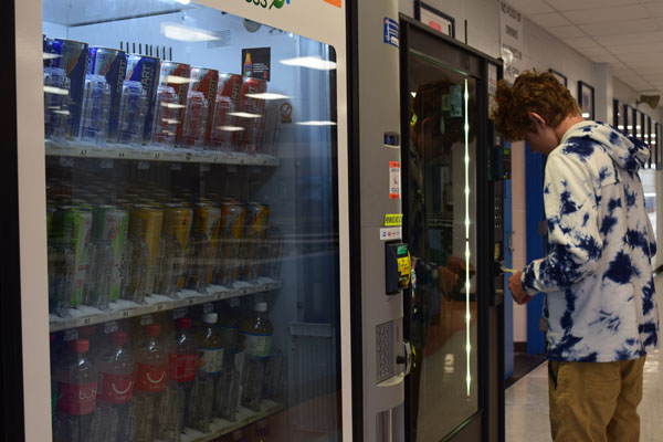 Sophomore Ethan Tuttle, buys snacks at the vending machine.