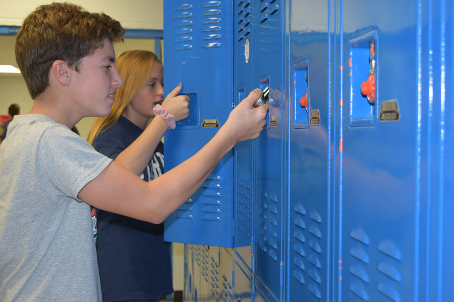 One+student+demonstrates+the+difficulties+some+students+could+have+with+their+lockers.