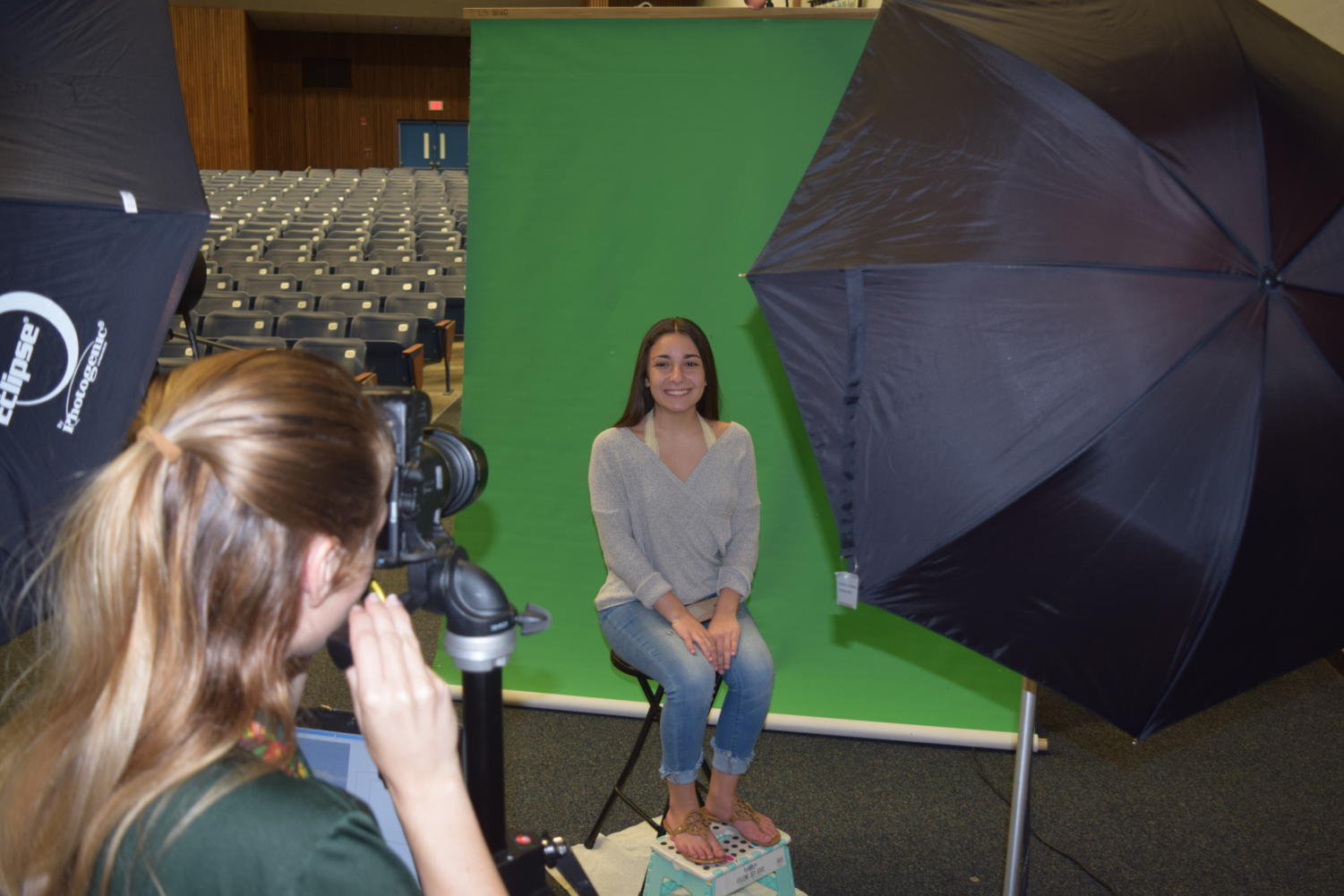 A Leonards photographer takes Gia Genoese's picture for yearbook.