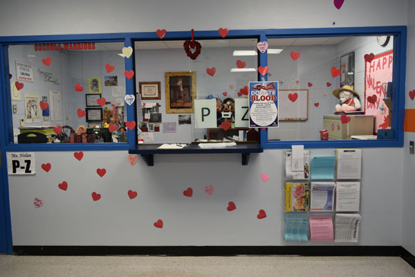 Student services is decorated with pink and red hearts for valentines day.