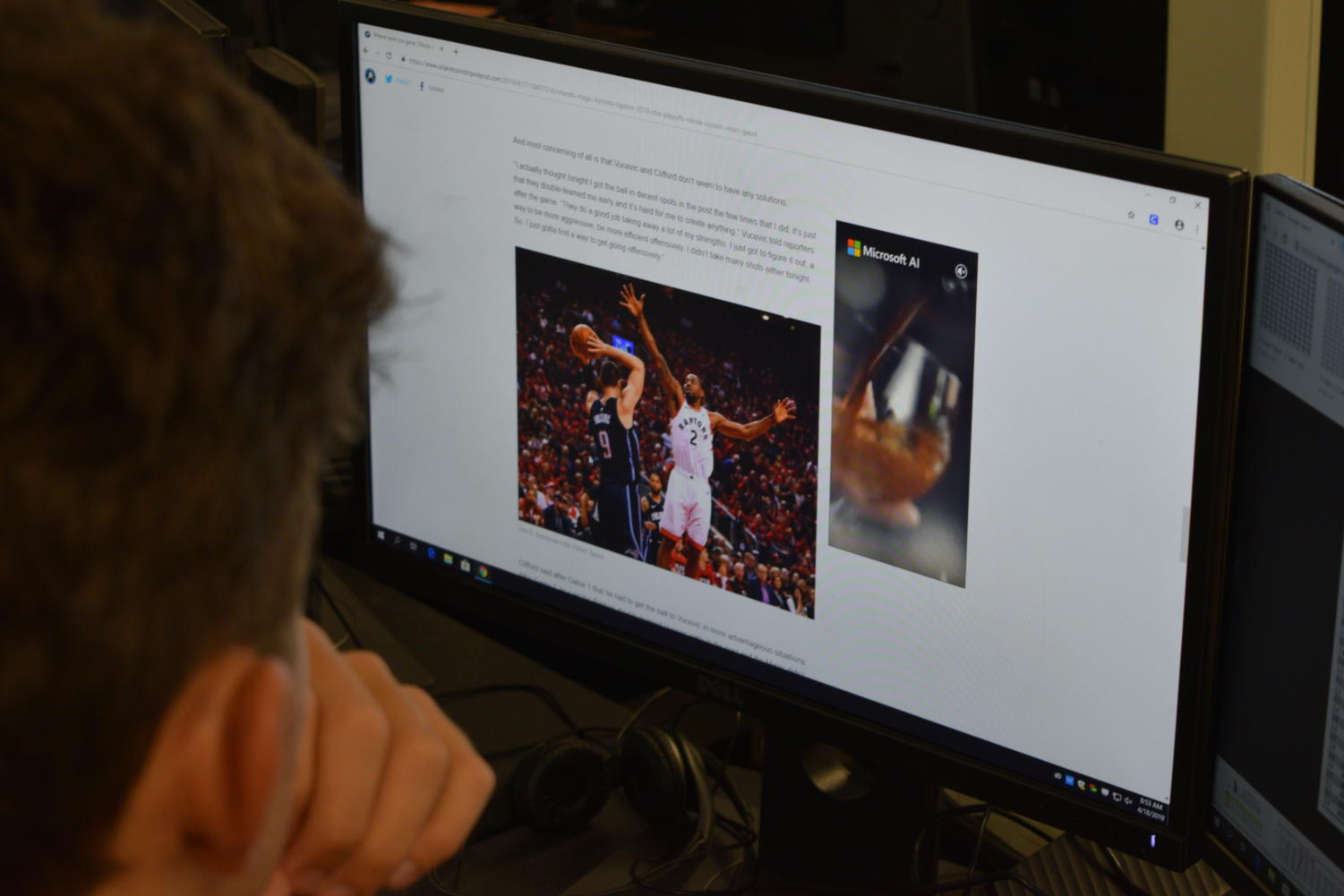 Sports fan Andre Ramirez looks at stats for the Magic game.