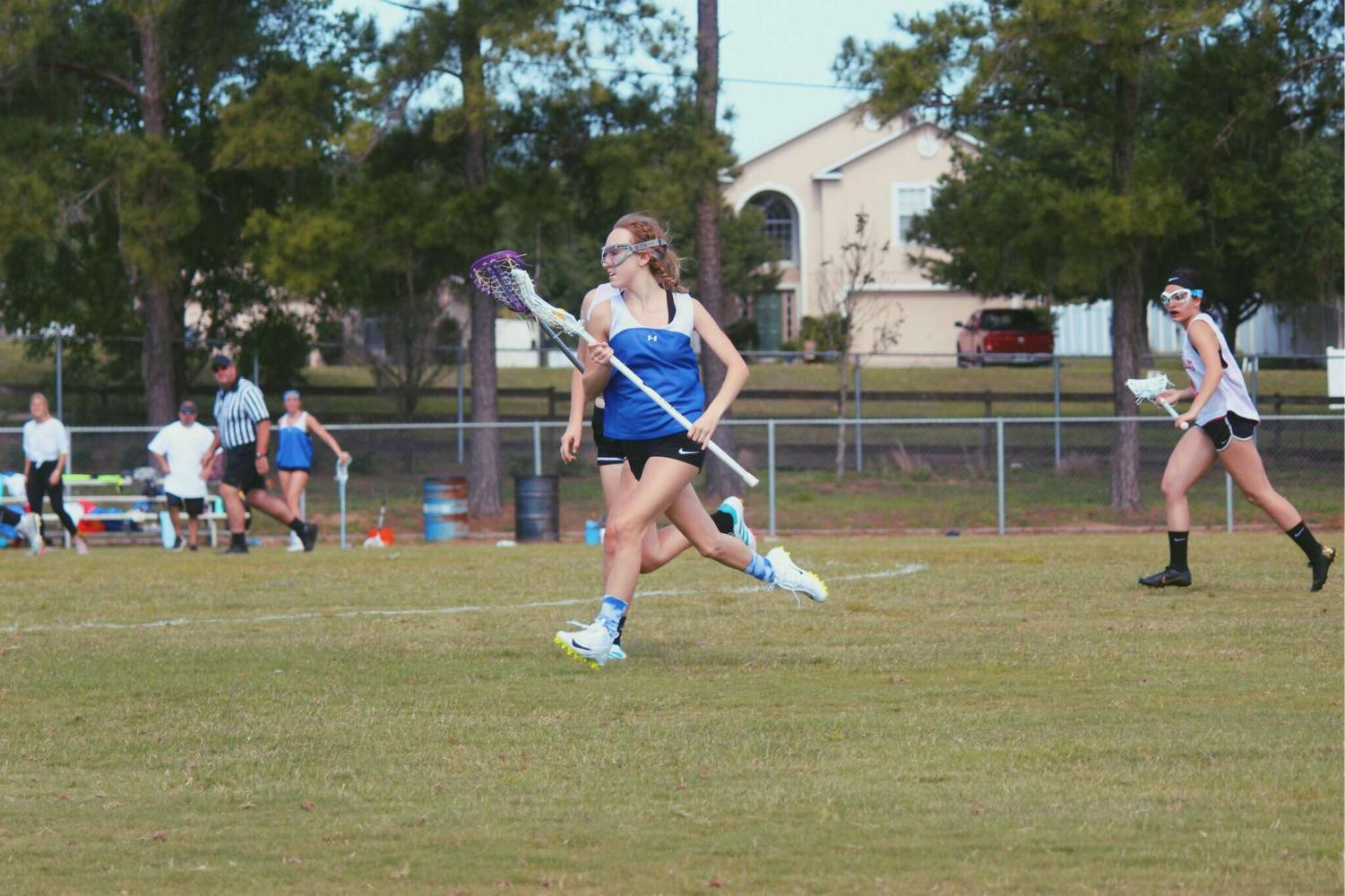 Oliva Severance, 9th grade, plays in her lacrosse game.