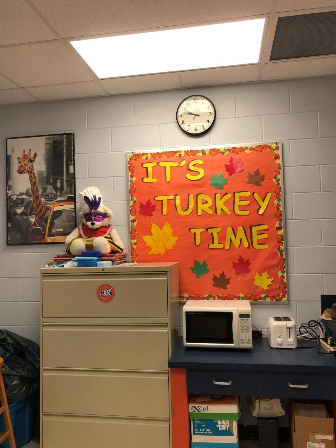 The office is decorated for Thanksgiving.