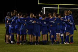 Boys huddle up before the big game.