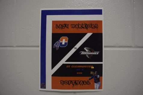 Posters around the school give updates on upcoming softball events.