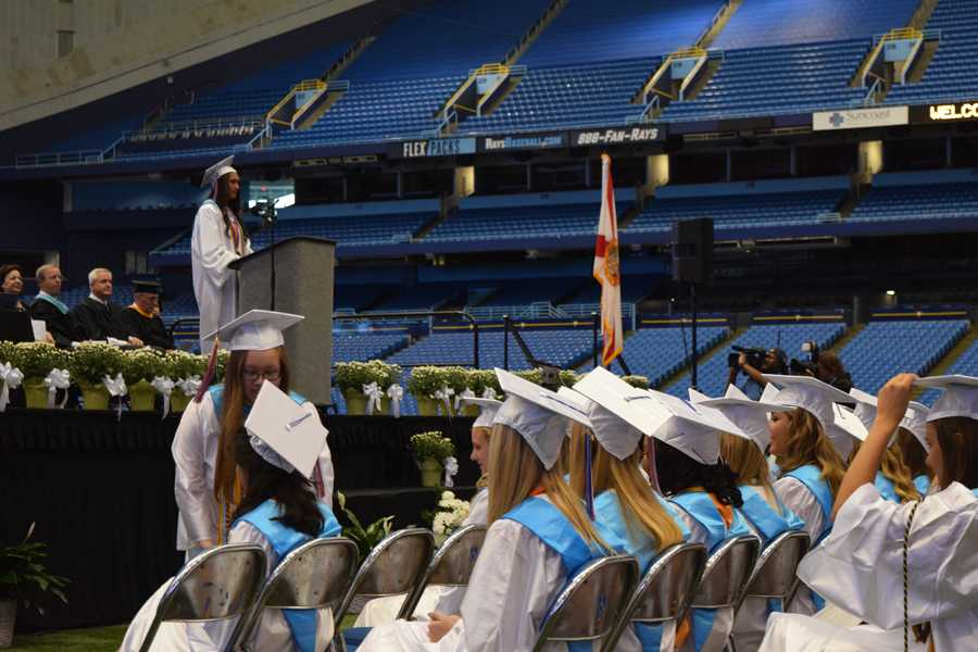 The+senior+class+president+of+2015+speaks+to+her+classmates+during+graduation.