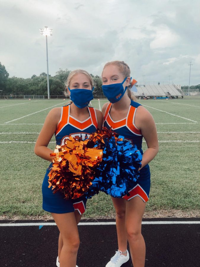 Grace and Payton still enjoy cheer despite difficulties due to Covid.