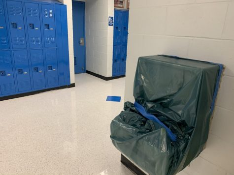The water fountains are covered up to keep students safe from COVID.