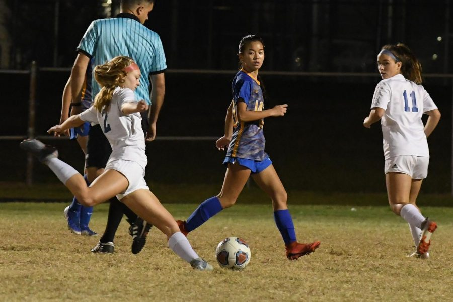 Kelli Slater, Forward, tries to score a goal against Largo High school in a game last year.