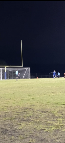 Chloe Cors kicks one of the final penalty kicks during the regional quarter final game.
