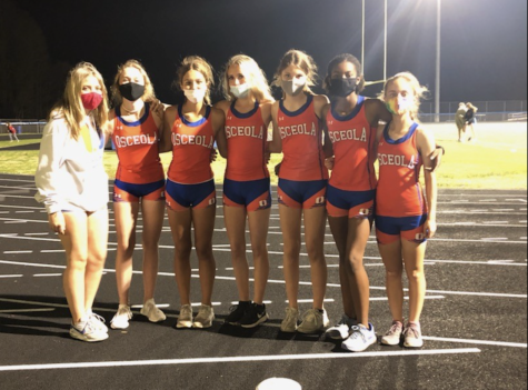 Lauren Wiseman, Kylie Houck, Marissa Eckel, Ryan Fair, Emma Perez, India Nichols, and Elle Mehltretter gather for a quick pic after a track meet.