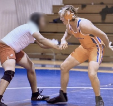 Coltan McClain, senior, during a wrestling match in the 2021 wrestling season.