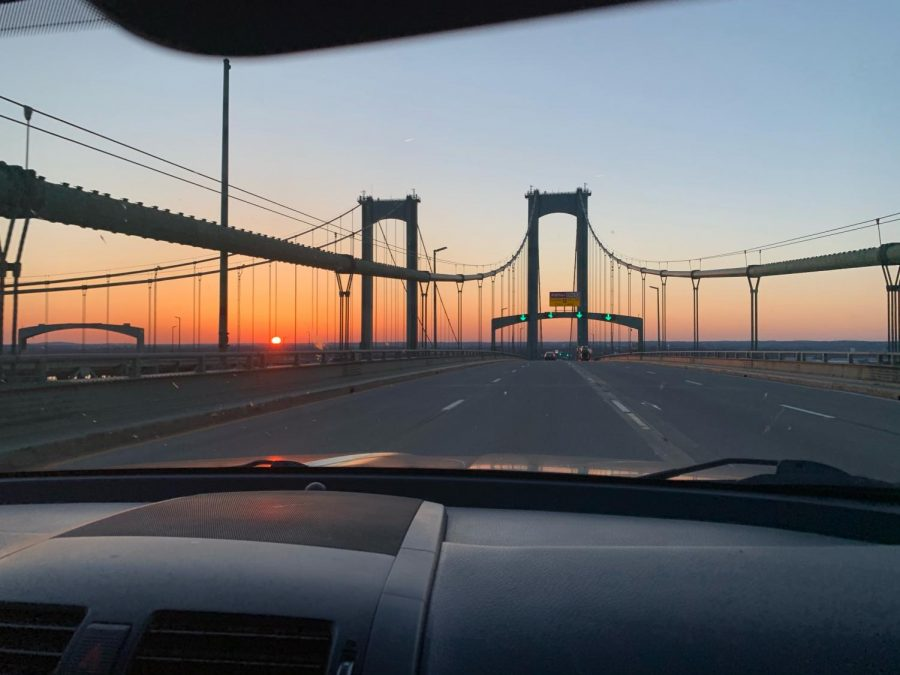driving over the bridge and watching the evening sunset.