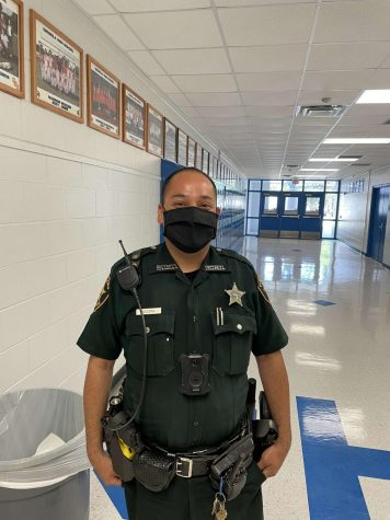 Deputy Nocera on duty in the hallways during school hours making sure everyone stays safe.