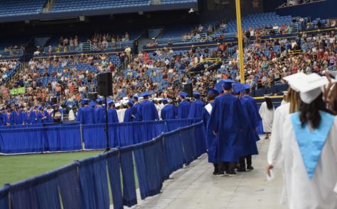 Seniors make their way to their seats.
